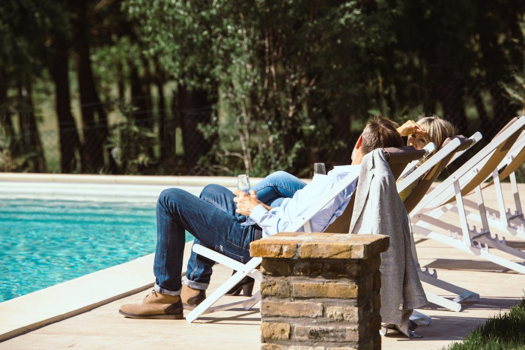 in Italy: Mark and Sara Hayes owners of No. 18 Casa di Capagna by pool.